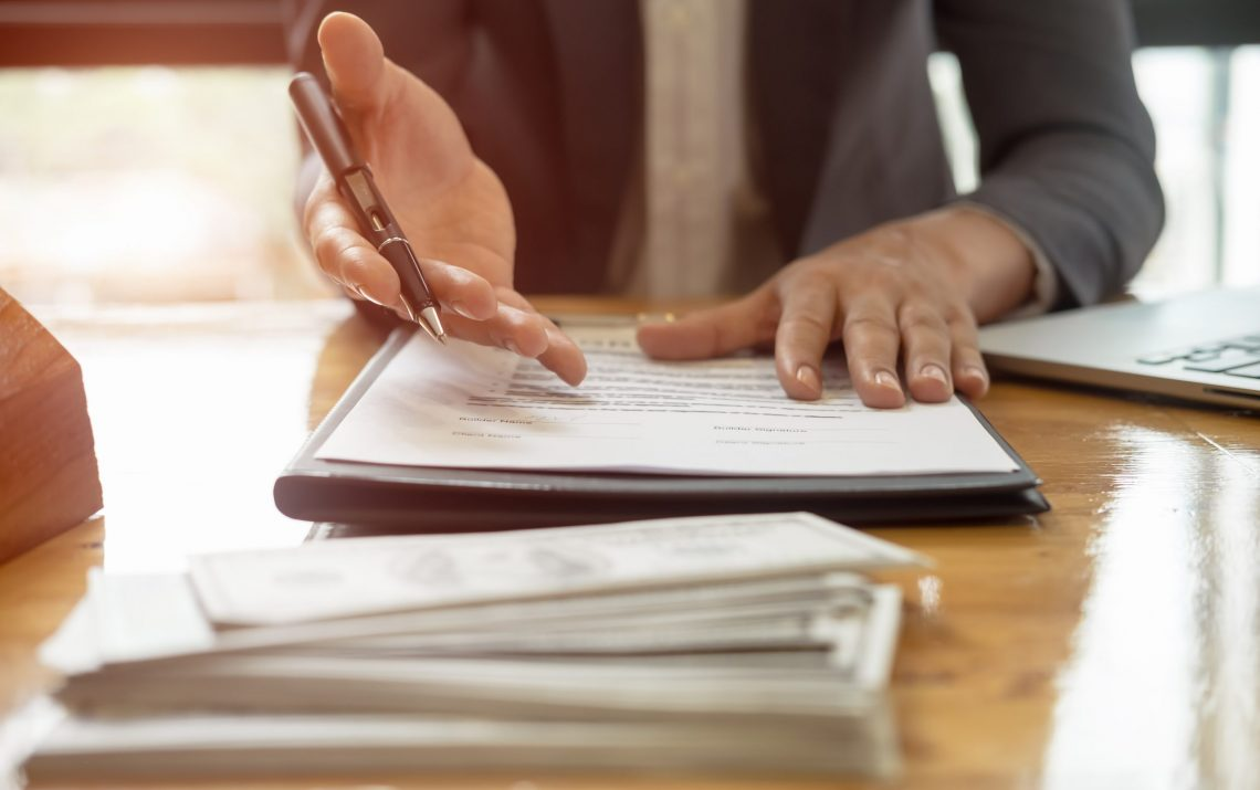 Close Up Business Man Reaching Out Sheet With Contract Agreement