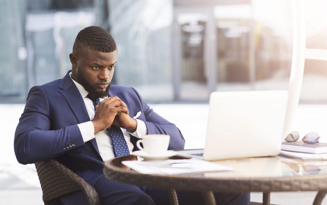 Coronacrisis And Bankruptcy. Thoughtful Black Businessman Sittin