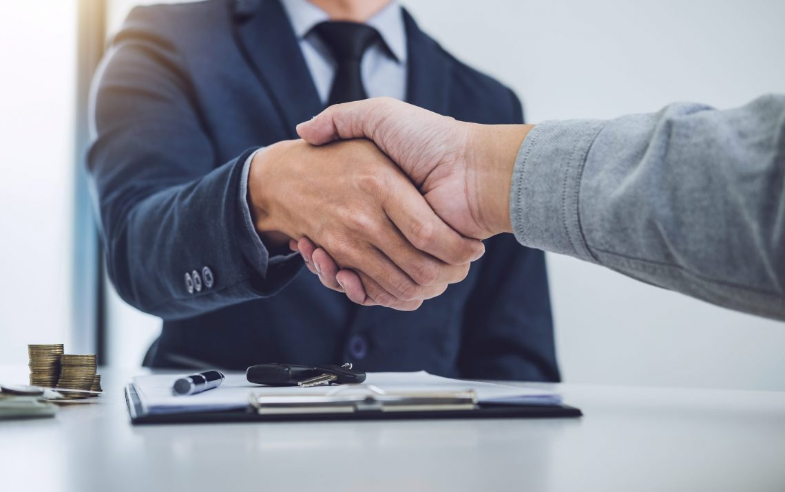 Handshake Of Cooperation Customer And Salesman After Agreement,